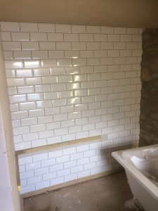 Traditional tiles cut into stone wall